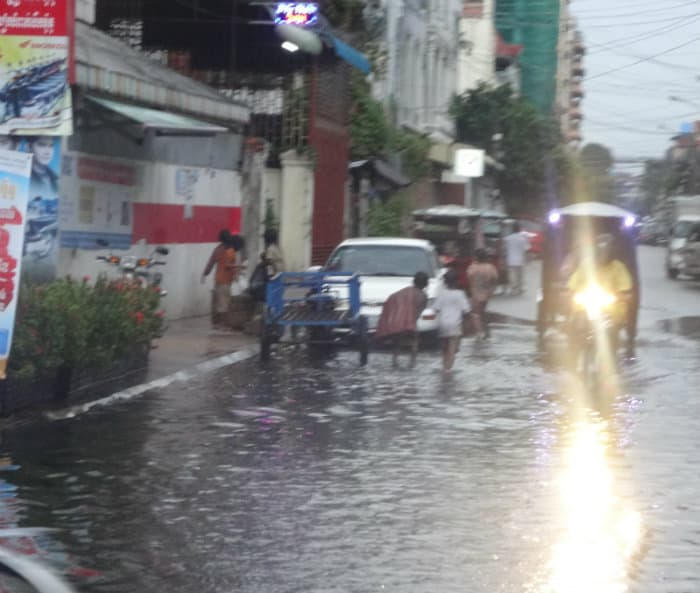 Flooded street and infrastructure investing in Cambodia