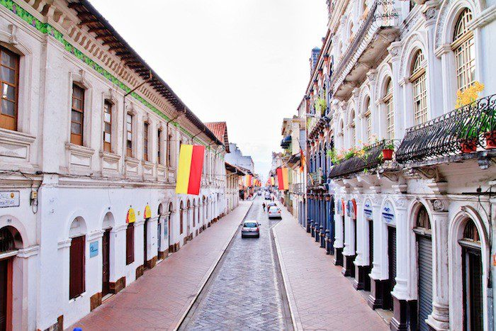 Cuenca, Ecuador boasts clean streets and European-style wrought iron balconies decorated with colorful flowers.