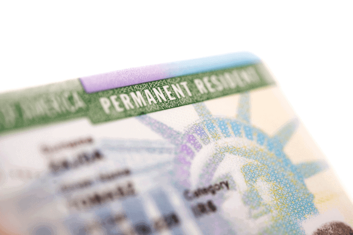 Permanent residence card placed in passport