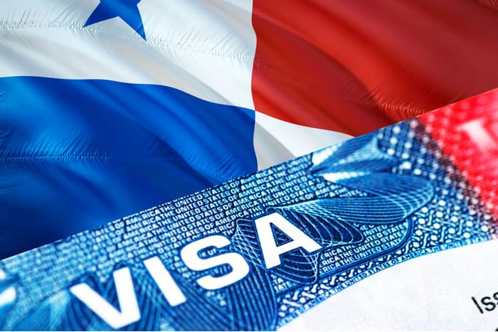 Visa resting on Panamanian flag